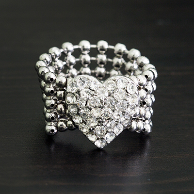 GUESS<sup>&reg;</sup> Stretch Pavé Heart Ring - This cute silver-tone band features a pavé crystal heart. Ring is nickel and lead free with a stretch band that fits up to size 7-8.